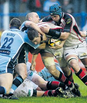 Ulster's Ryan Caldwell drives towards the line assisted by Matt McCullogh