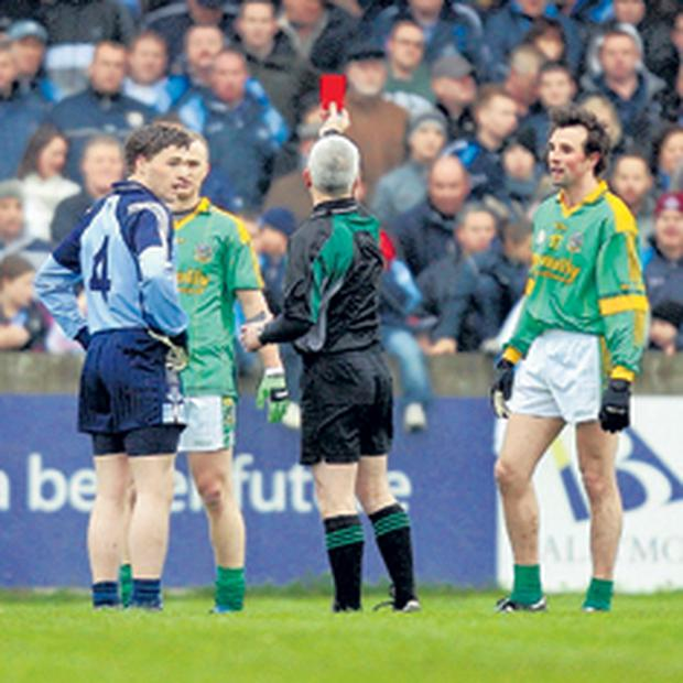 Paddy Russell shows the red card during Dublin and Meath's match
