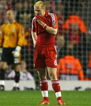 Liverpool's John Arne Riise cannot hide his despair after scoring an own goal against Chelsea