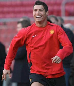 Cristiano Ronaldo enjoys yesterday's training session at the Nou Camp in Barcelona