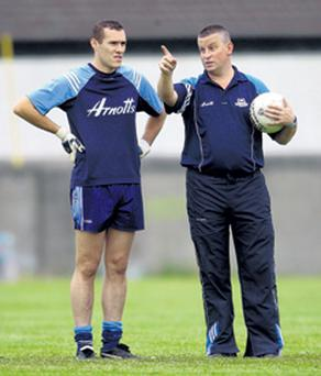 Dublin manager Paul Caffrey (right) with Ciaran Whlean, the only player to date who has apologised for his part in last Sunday's violence