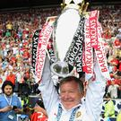 Alex Ferguson celebrates with the Premiership trophy after Manchester United's 17th league title