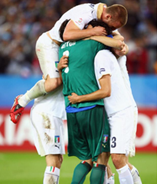 Italy players celebrate after last night's win against France which sent them through to the quarter-finals