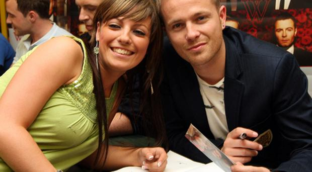 Westlife's Nicky with one of the hundreds of fans who turned up to see the band at Eason's Donegall Place store in Belfast