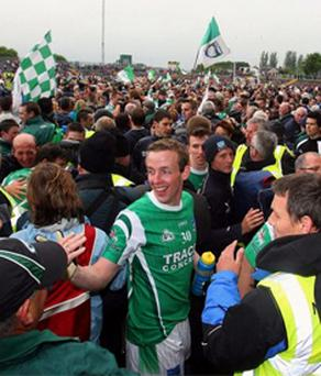 Fermanagh's players and fans celebrate the win over Derry