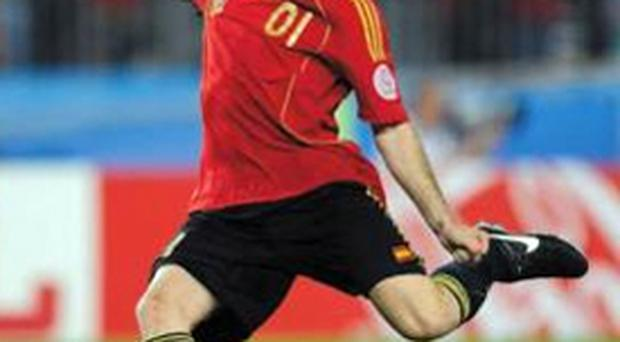 Cesc Fabregas scores the winning penalty last night in Vienna as Spain reached their first major semi-final in 24 years