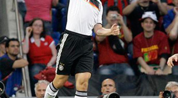 Germany's Miroslav Klose celebrates scoring his side's 2nd goal during the quarter-final match between Portugal and Germany in Basel, Switzerland, Thursday, June 19, 2008, at the Euro 2008 European Soccer Championships in Austria and Switzerland. (AP Photo/Ivan Sekretarev)
