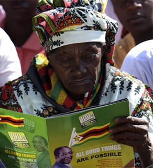 A woman at President Robert Mugabe's rally west of Harare