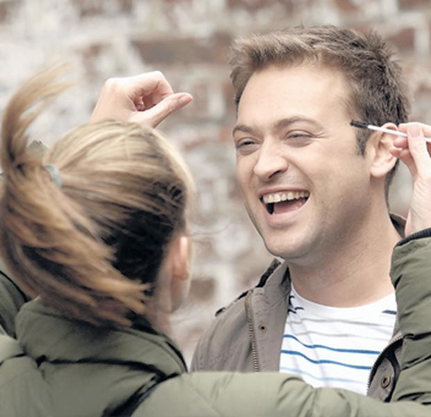 Actor Paul Nicholls shares a joke with a make-up girl on the set of Billy Goats' Gruff shooting in Belfast