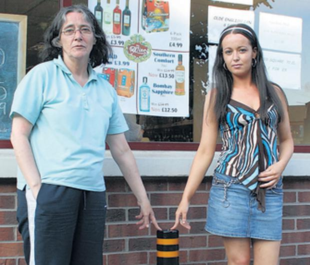 Elizabeth Skelly and her daughter, Clare Skelly who live next door to the targeted Off Licence on the Springfield Road