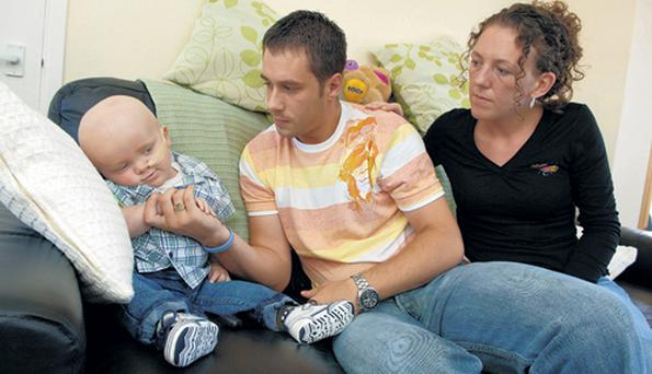 Gary Dicks and partner Carrie Davidson with baby son Dylan at their north Belfast home yesterday