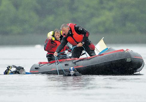 Divers searching the waters of Lough Erne near Devenish Island yesterday