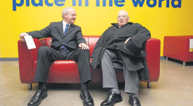 First Minister Dr Ian Paisley and Deputy First Minister Martin McGuinness take a break during the opening