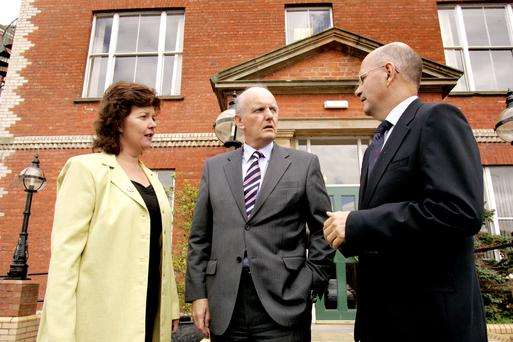 Minister for Health, Social Services and Public Safety Michael McGimpsey (centre) alongside South Eastern Health and Social Care Trust members Denise Fitzsimons and John Compton