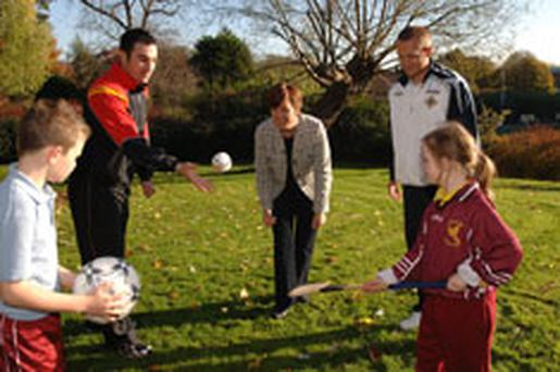 (L-r) Jack Smith, Castle Gardens PS, Newtownards, Ryan Mallon, Tyrone County GAA Player, Education Minister Caitríona Ruane, Sammy Clingan, Northern Ireland and Nottingham Forest footballer and Chloe O'Donnell, Scoil na Fuiseoige
