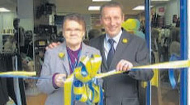 Betty Dempster, the longest serving volunteer from the former shop, officially opens the new shop with Marie Cancer Care's John Canessa