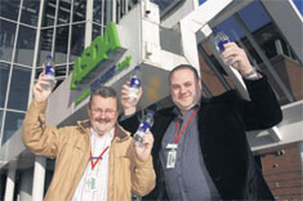 Healey Martin (left) and Angus O'Neil, managers of the ASDA stores at Bangor and Newtownards, which won a national competition run by charity Thirsty Planet