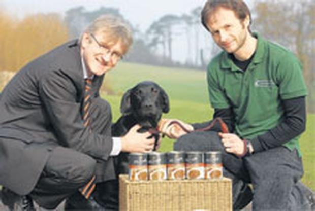John Mackle, of sponsors McGrath dog food, and Mert Thompson, warden of Crawfordsburn Country Park are joined by local cross-breed Chester, to launch Bark in the Park
