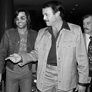 John Chaffetz, an official of the Los Angeles Aztecs, points the way for soccer star George Best. Best was attending a press conference after joing the Aztecs in 1976