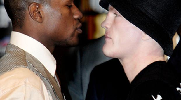 Floyd Mayweather Jr. and Ricky Hatton (R) go face to face during the final press conference