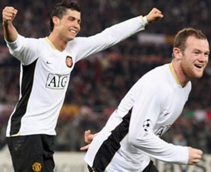 Wayne Rooney (R) and Cristiano Ronaldo of Manchester United celebrate after Rooney scored their second goal during the UEFA Champions League quarter-final