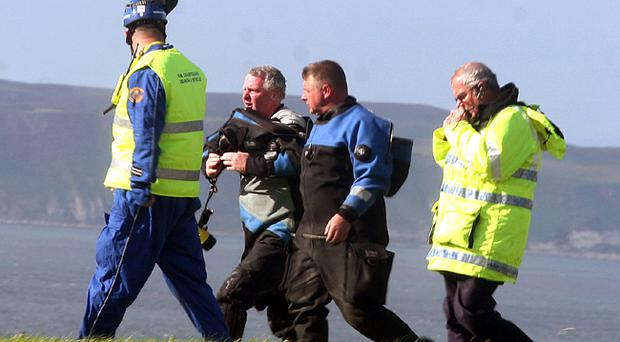 Divers from the Newry and Mourne Dive Club arrive in Ballycastle after being airlifted from Rathlin