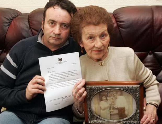 Vindicated: Sarah Conlon and son Gerry hold the letter of apology from PM Tony Blair