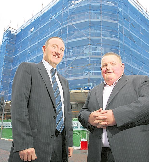 Keith Freeman, cluster manager for Premier Inn, Belfast, shows Gerry Lennon, chief executive of the Belfast Visitor and Convention Bureau, the progress at Premier Inn's newest Belfast hotel at the Four Corners in the Cathedral Quarter