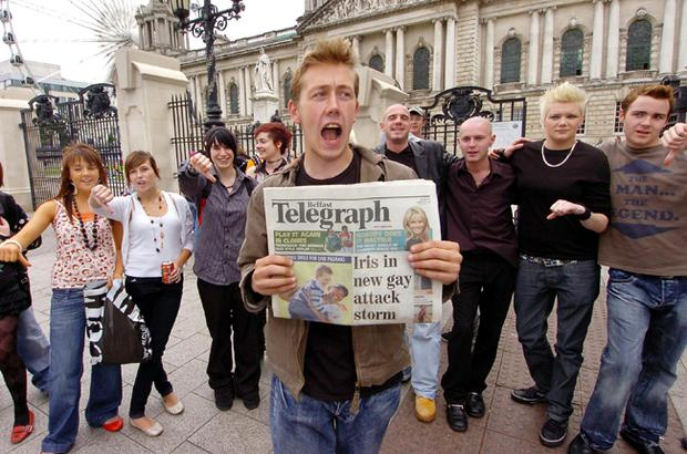Steven Colhoun brandishes a copy of yesterday's Belfast Telegraph during a protest outside Belfast City Hall