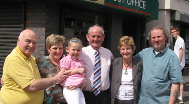 (L-r) Alfie Dean of the Windsor Snooker & Recreational Club, with members of the McDonald family Heather, Ruth, Sam and Isobel, and local resident Jim Laverty outside the Lisburn Road post office branchs