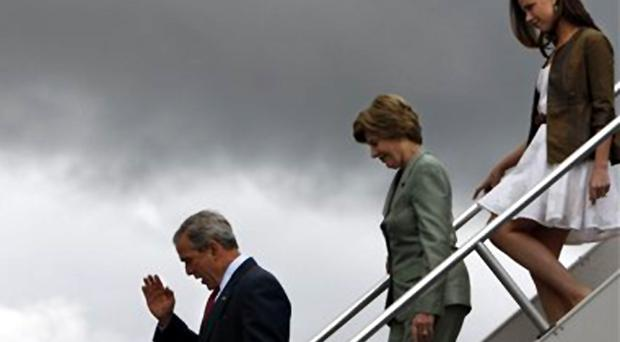 President Bush salutes as he arrives with first lady Laura Bush and daughter Barbara Bush to make remarks to military personnel at Eielson AFB, Alaska, Monday, Aug. 4, 2008.