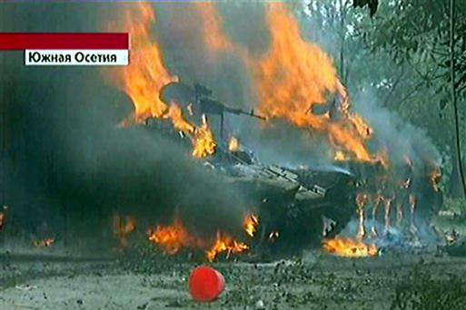 Russian First Channel claims these are burning Georgian armored vehicles are seen in Tskhinvali in the South Ossetian breakaway region of Georgia on Friday, Aug. 8, 2008.