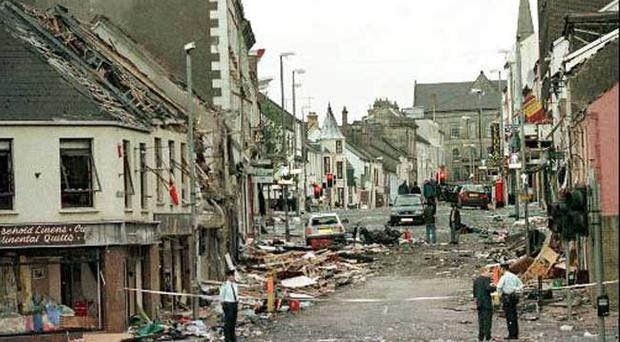 Royal Ulster Constabulary Police officers stand on Market Street, the scene of the bombing in August 1998