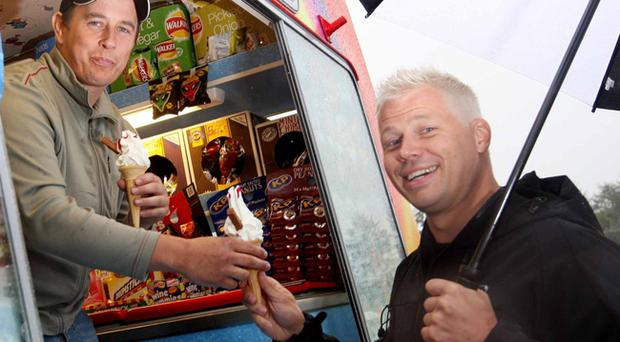 John McGuinness and Mats Nilsson are determined to enjoy their ice cream at the side of the circuit.