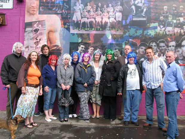Markets residents at the unveiling of one of three new murals depicting the sporting, industrial and social history of the area. Also included in the picture is local snooker star Joe Swail (second from right)