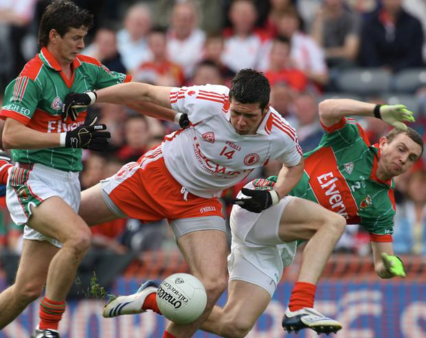 Sean Cavanagh is pressurised by Mayo's Aidan Higgins (left) and Keith Higgins during this year's qualifiers