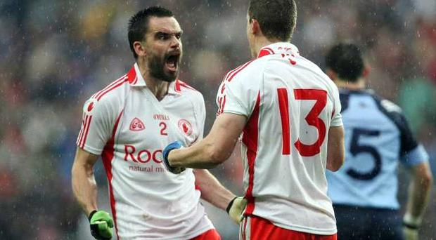 Tyrone's Ryan McMenamin celebrates an early point in against Dublin