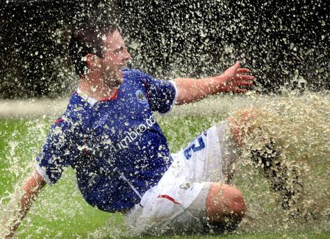 Jamie Mulgrew made a splash after scoring for Linfield against Cliftonville on Saturday but his goal won't enter the record books as the match was abandoned at 1-0 after 32 minutes with the pitch waterlogged