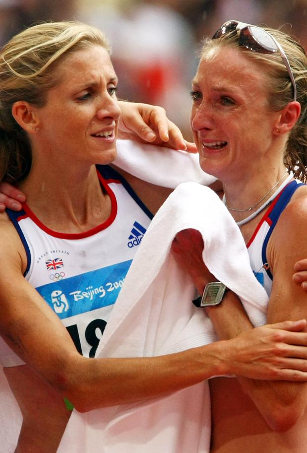 Liz Yelling of Great Britain consoles Paula Radcliffe of Great Britain after the Women's Marathon Final held at the National Stadium on Day 9 of the Beijing 2008 Olympic Games on August 17, 2008 in Beijing, China. Paula Radcliffe of Great Britain finished the event in 23rd place with a time of 2.32.38