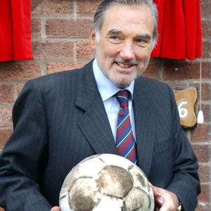 George Best in April 2002 at the house in Burren Way, where he unveiled a plaque after being awarded the freedom of Castlereagh
