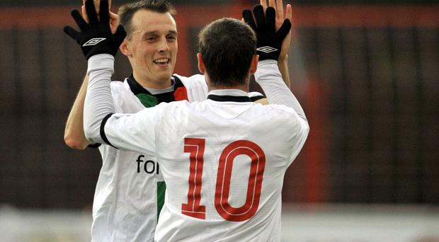 Gary Hamilton takes the congratulations of strike partner Michael Halliday on his way to a hat-trick for Glentoran against Newington YC