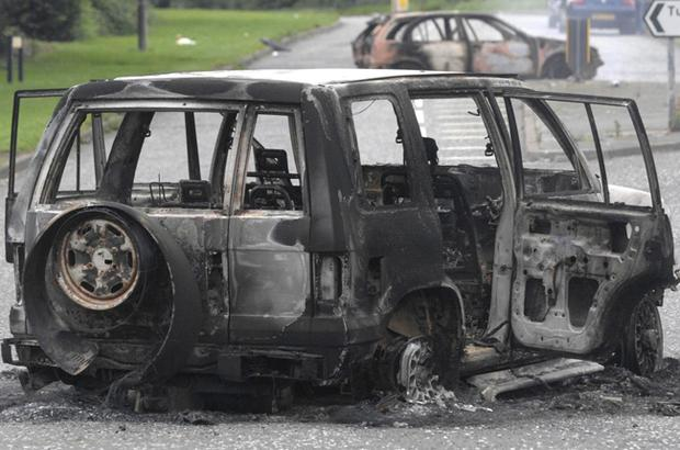 One of the vehicles which was burnt-out when trouble flared yesterday in the nationalist Tullygally and Drumbeg estates in Craigavon.