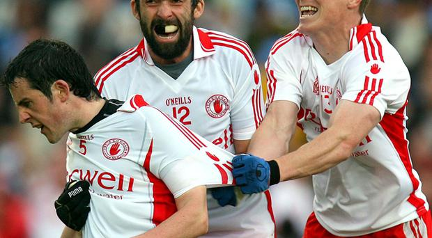 Tyrone star Davy Harte celebrates his goal against Dublin in the All-Ireland quarter-finals with Tommy McGuigan and Joesph McMahon.