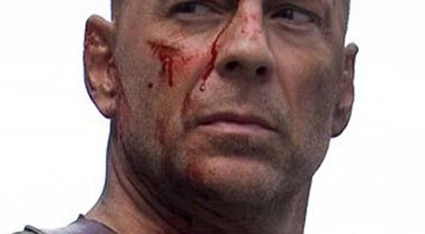 Bruce Willis, an original 'he-man' knows how to look mean and moody.