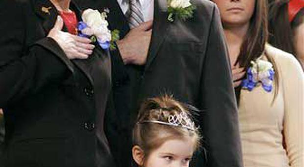 In this Dec. 4, 2006 file photo, Gov. Sarah Palin, left, her husband Todd, and daughters Bristol,16, right, and Piper, 5, front stand as the colors are retired at the end of an inauguration ceremony in Fairbanks, Alaska Palin, 42, is the first female and youngest governor of Alaska. John McCain tapped little-known Alaska Gov. Sarah Palin to be his vice presidential running mate.