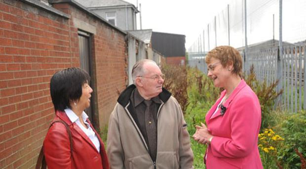 John Harrison/Harrison Photography DSD Minister Margaret Ritchie with John Copeland ,Chairman of the Lorne Street Residents Group ,Off Lisburn Road Belfast and Anna Lo MLA as she visited the area to meet reidents to discuss improvements that need made to the area.Photo John Harrison.