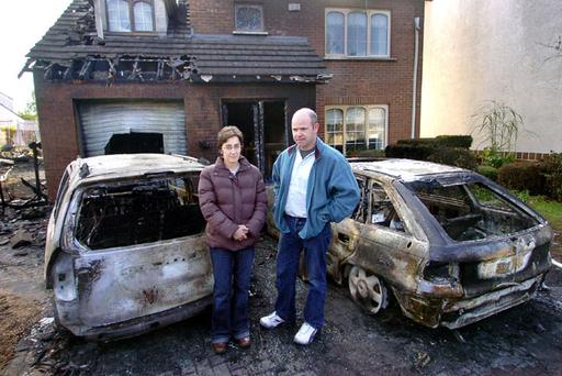 Colin and Catherine Donnelly outside their destroyed home yesterday following the massive blaze on Saturday night
