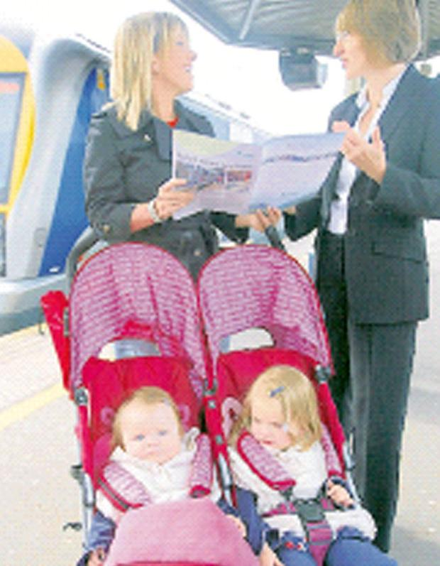 Catherine Mason (right), group chief executive of Translink, discusses proposals for new NIR trains with commuter Lindsay Bell, who is accompanied by her children Ellie and Lilly. Translink is due next March to sign a £100m contract for 20 trains