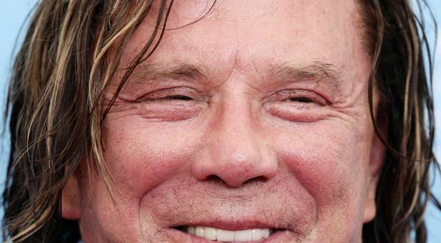 Mickey Rourke arrives for the press conference and photocall of 'The Wrestler' at the Palazzo del Casino on Venice Lido, Italy, during the 65th Venice Film Festival.