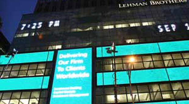 The Lehman Brothers' name is illuminated at the headquarters of Lehman Brothers Holdings Inc. September 15, 2008 in New York City